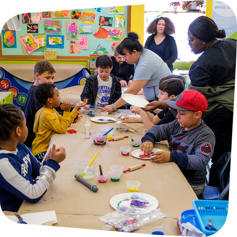 Children and adults creating arts and crafts.