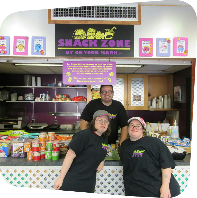 Snack Zone staff posing in front of Snack Zone.
