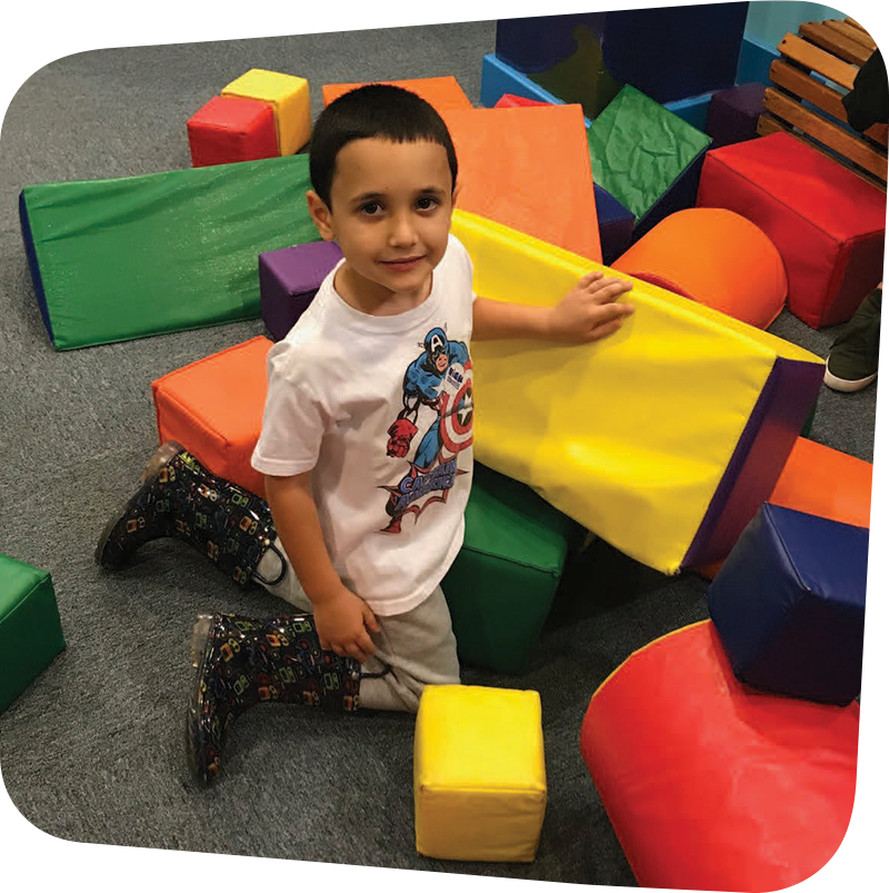 Child playing with colorful foam blocks