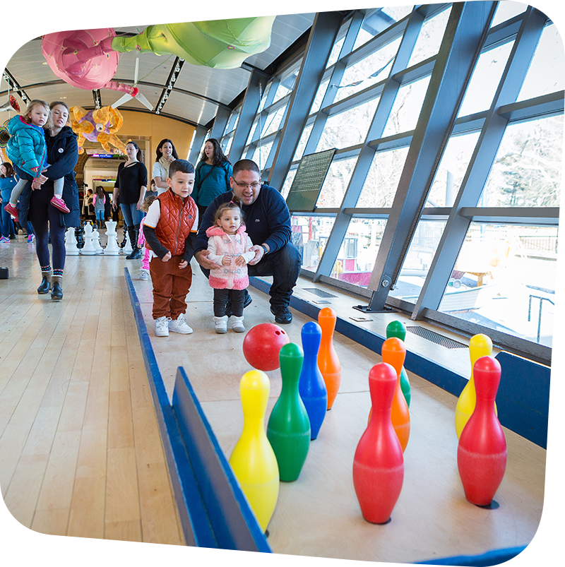 children and adult bowling in big games exhibit