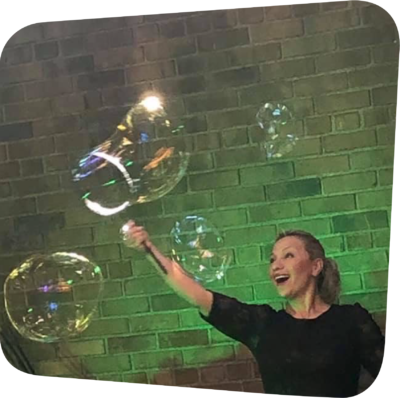 smiling woman surrounded by bubbles