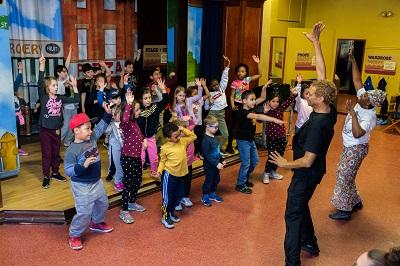 Walter leading kids in dance